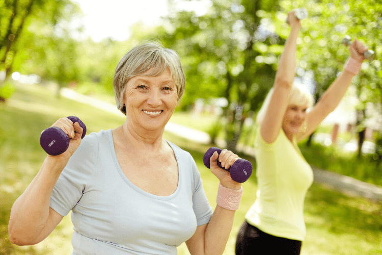 two smiling women exercising for weight loss