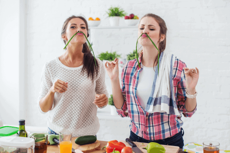 two women enjoying making a healthy meal