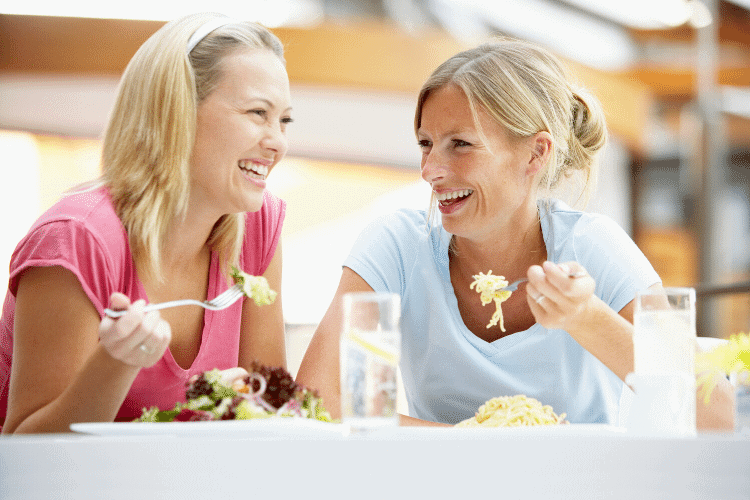 two women eating together using the principles of intuitive eating