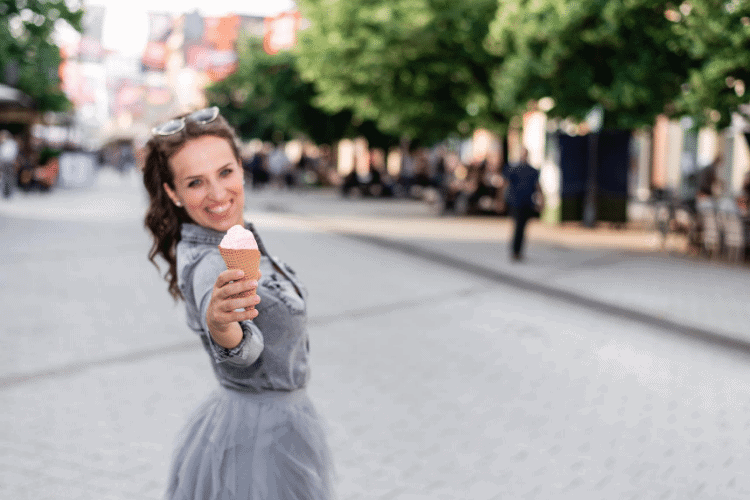happy woman enjoying ice cream