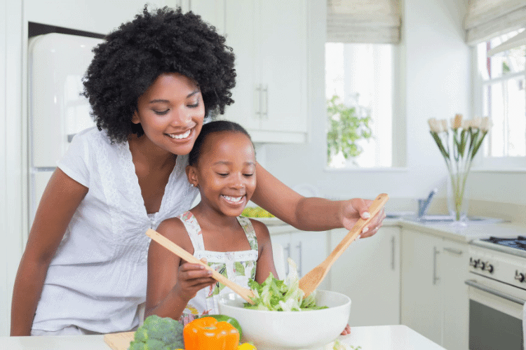 woman and her daughter preparing a healthy meal together