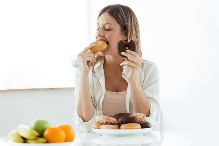 woman binge eating donuts