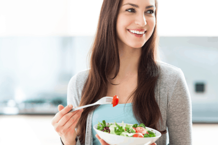 smiling woman eating healthy food