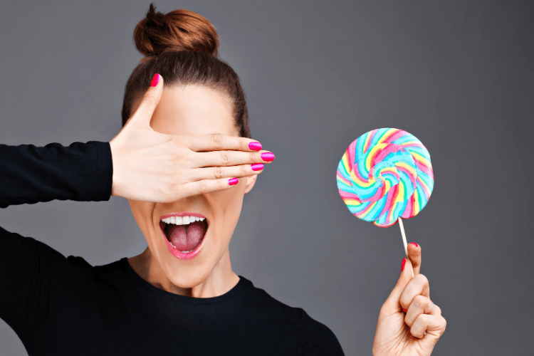 smiling woman with candy lollipop