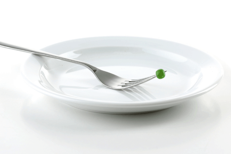 empty plate with fork and pea