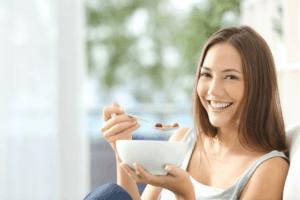 smiling woman eating