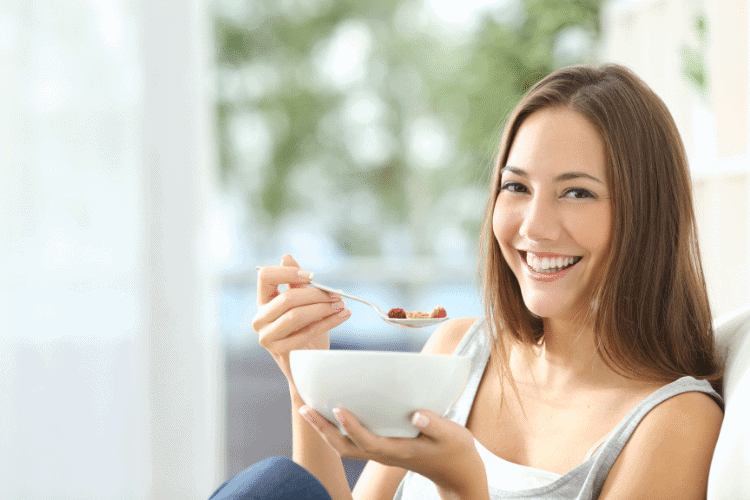 smiling woman eating | freedom from food