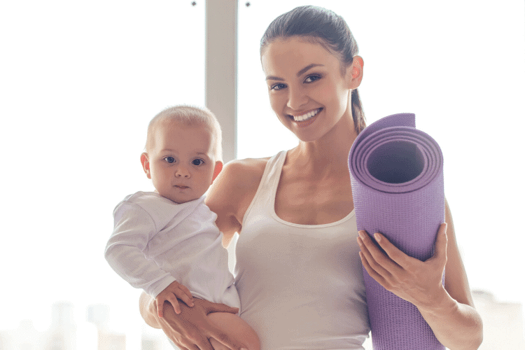 woman with baby and exercise mat
