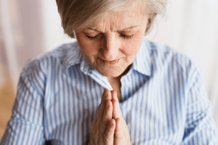 lady praying with hands folded