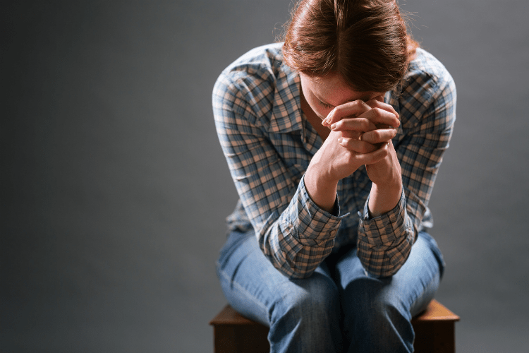 woman praying for weight loss