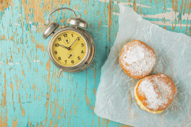 pastries on a table with a clock