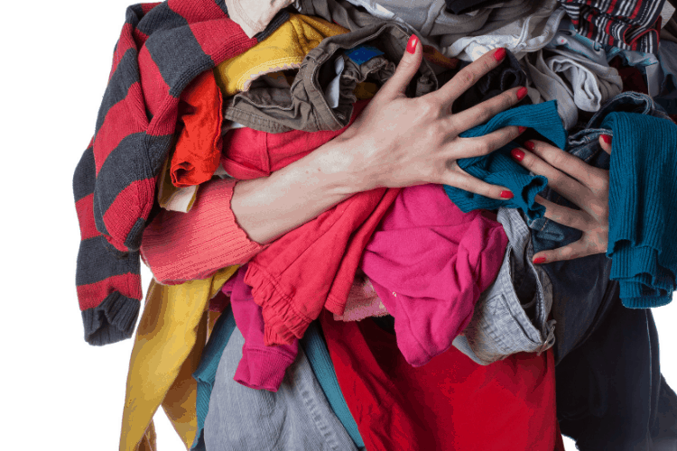 woman with arms full of clothes