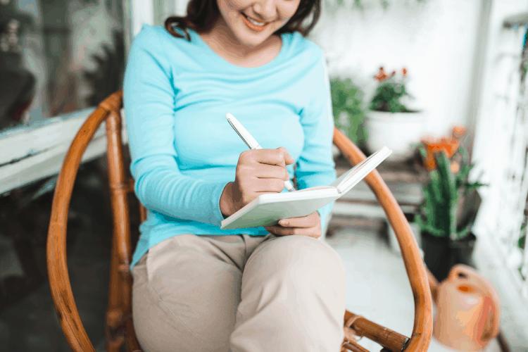 image of woman journaling