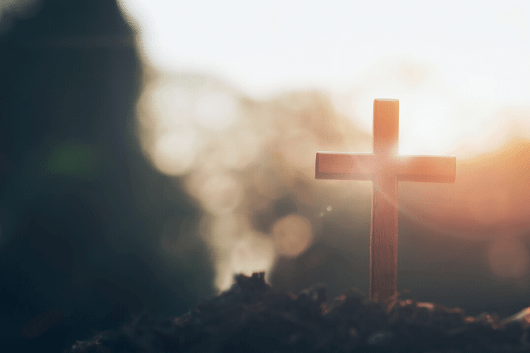 cross with sunrise behind