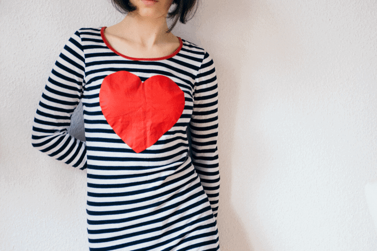 woman wearing striped shirt with red heart