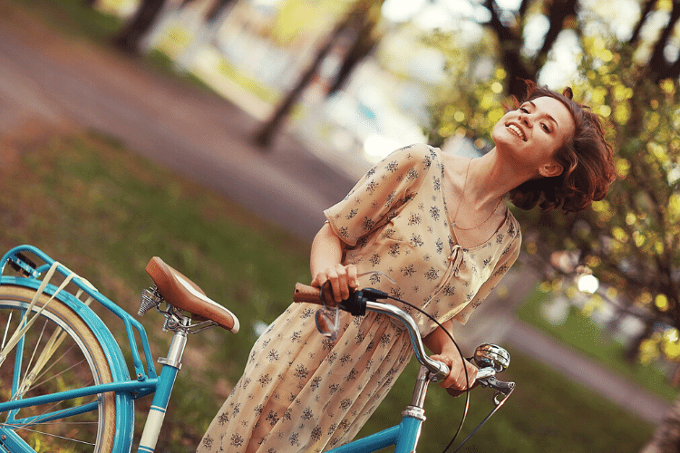 image of woman smiling on bike