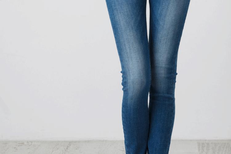 woman legs wearing jeans