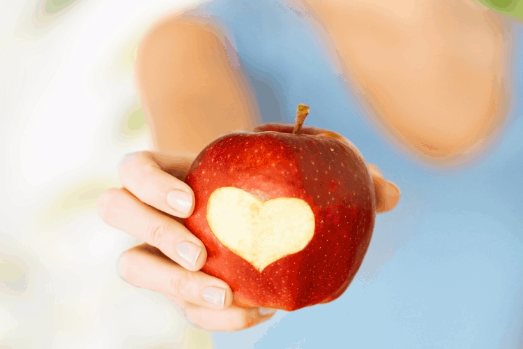 apple with a heart-shape cut into it