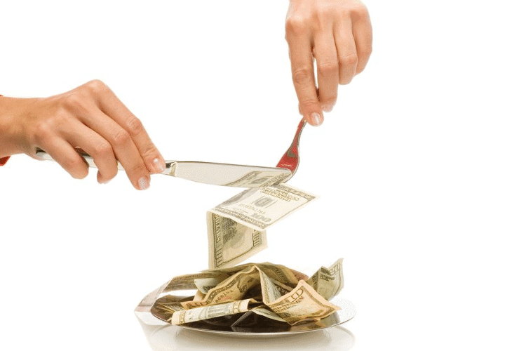 image of money on a plate with a fork and knife
